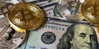 bitcoins-and-u-s-dollar-bills-730547